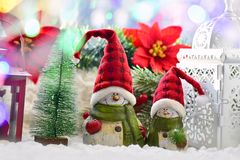 Christmas window decoration with snowmen in santa hats and old l Stock Image