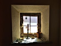 Christmas and window, enchanting details and light. Charistmas and window, enchanting details and light, candle, decoration and mystery, symbols and fascination royalty free stock photo