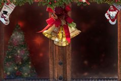 Christmas window,golden bells,decorations,snow,tree background for greeting card space for text stock photo