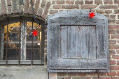 Christmas window with wooden shutter. The photo shows a Christmas decorated window with shutter stock photography