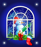 Christmas window with snowman Royalty Free Stock Photo