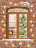Christmas through window. View through a window on the interior of a Christmas living room with the Christmas tree and fireplace. The brick facade of the house Stock Images