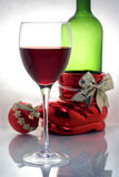 Christmas wine. A glass of wine with bottle and christmas ball Stock Photography