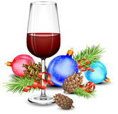Christmas wine glass. Cones, green branch, ball and ribbon, isolated on white Royalty Free Stock Image