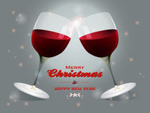 Christmas wine glasses background. Wine Glasses Touching Over Merry Christmas Text on Festive Glowing Background Royalty Free Stock Photos