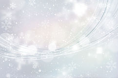 Christmas winter background with abstract snowflakes and shines Royalty Free Stock Photo