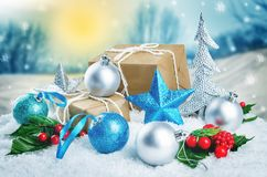 Christmas winter background with gifts, colored balls and star stock image