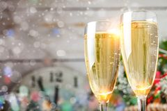 Christmas winter background. New Year`s toys. Happy New Year and Merry Christmas. Christmas winter background, New Year`s toys and champagne. Happy New Year and Royalty Free Stock Images