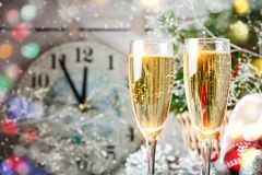 Christmas winter background. New Year`s toys. Happy New Year and Merry Christmas. Christmas winter background, New Year`s toys and champagne. Happy New Year and Stock Image