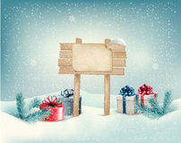 Christmas winter background with presents and wood Stock Image