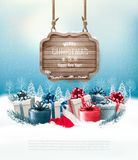 Christmas winter background with presents and wooden board. Stock Photos