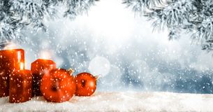Free Christmas Winter Background. Red Candles And Baubles. Spruce And Pine Branches Over The Board Covered With Snow. Stock Photos - 162735543