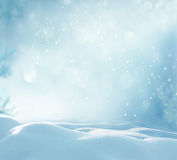 Christmas winter background with snow. And blurred bokeh Royalty Free Stock Image
