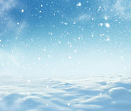 Christmas winter background with snow and blurred bokeh. Royalty Free Stock Images