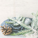 Christmas winter background with snow branches. Square. Christmas winter gray background with fir tree branches, pine cones, baubles and snow. New year greeting Royalty Free Stock Photos