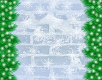 Christmas winter background. With Christmas tree branches and snowflakes on frosty brick wall with copy space for text Stock Photo