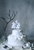 Christmas winter cake with cream of whipped egg whites. Still life. The picture winter holiday. A cake of whipped egg whites, decorated Christmas trees for Royalty Free Stock Photos