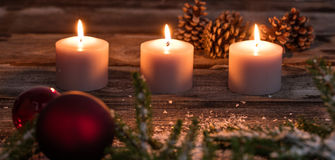 Christmas winter candlelight with candles and tree bulb on wood Royalty Free Stock Images