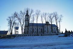 Christmas winter church. Lonely forgotten church somewhere on the sidelines of the Polish countryside in the winter twilight royalty free stock image