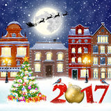 Christmas winter city street. Happy new year and merry Christmas winter old town street with christmas tree. Santa Claus with deers in sky above the city Royalty Free Stock Photo