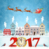 Christmas winter city street. Happy new year and merry Christmas winter old town street with trees. Santa Claus with deers in sky above the city. concept for Stock Photo