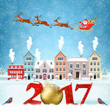 Christmas winter city street. Happy new year and merry Christmas winter old town street with trees. Santa Claus with deers in sky above the city. concept for Royalty Free Stock Photography