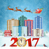 Christmas winter city street. Happy new year and merry Christmas winter city street with trees. Santa Claus with deers in sky above the city. concept for Stock Photos