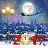 Christmas Winter Cityscape. Happy new year and merry Christmas Winter Cityscape with luminous street lantern,Santa Claus with deers in sky above the city. 2017 Royalty Free Stock Image