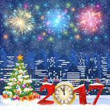 Christmas Winter Cityscape. Happy new year and merry Christmas Winter Cityscape with christmas tree, snow flakes. Christmas card with cityscape and fireworks Royalty Free Stock Image
