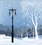 Christmas Winter Cityscape with luminous street light, snow Stock Images