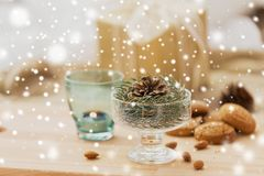 Christmas fir decoration with cone in dessert bowl stock photos