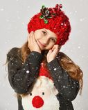 Christmas winter concept - smiling little girl kid in x-mas santa helper red hat happy smiling. On white background royalty free stock images