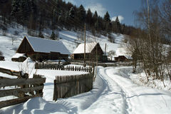 Christmas, Winter at countryside. Winter at countryside. Romanian village with wood fence on winter time Royalty Free Stock Photography
