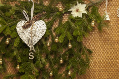 Christmas winter decoration on natural rustic straw wall Stock Photo
