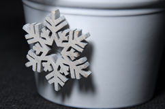 Christmas winter decoration of White wooden snowflake on pot Royalty Free Stock Photo