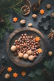 Christmas Winter decorations, nuts, spices and stars still life Royalty Free Stock Photos