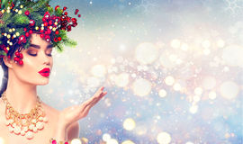 Christmas winter fashion girl with magic snow in her hand royalty free stock image
