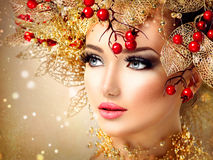 Christmas winter fashion model girl. With golden hairstyle royalty free stock image