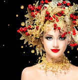 Christmas winter fashion model girl. With golden hairstyle stock images