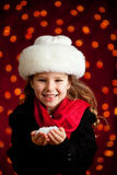 Christmas: Winter Girl Holding Handful of Snow Stock Images