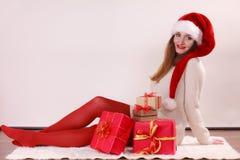 Happy woman make christmas presents Stock Photography