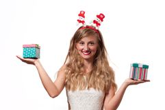 Christmas. Beautiful girls holding christmas gifts Royalty Free Stock Photo