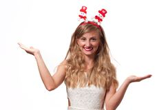 Christmas. Happy beautiful woman showing open palms Royalty Free Stock Photography