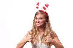 Christmas. Happy beautiful woman showing thumb up Royalty Free Stock Photo