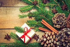 Christmas and winter holidays rustic background text space. Branch of christmas tree and gift on rustic wood Stock Photo