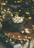Christmas winter hot chocolate with marshmallows in dark mug Royalty Free Stock Image