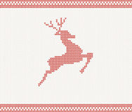 Christmas and Winter knitted pattern with deer Royalty Free Stock Photo