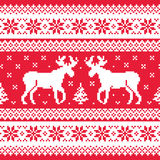 Christmas and Winter knitted pattern with reindeer Royalty Free Stock Images