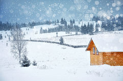 Christmas winter landscape with a small wooden hut in the mounta Stock Photography