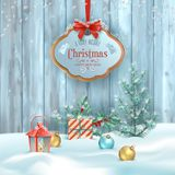 Christmas Winter Landscape. Vector Christmas winter landscape with hanging wooden sign, frosty Christmas tree, gifts and decorations on the background of wooden Stock Photo